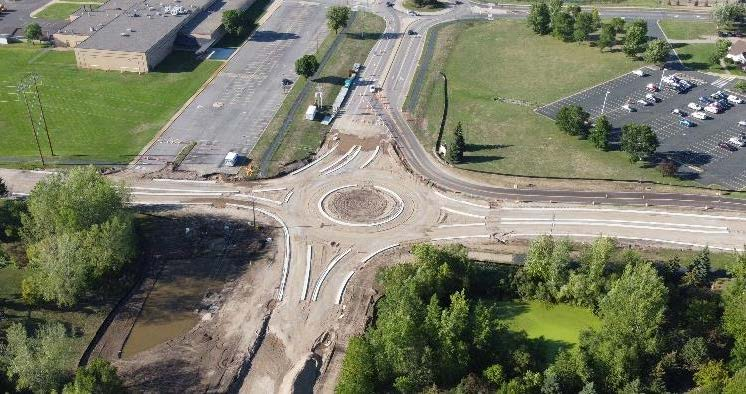 A majority of the grading, curb, gutter, and utility work is done (aerial image of the roundabout).